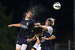 02 October 2012: Georgia Southern's Reed Norton (4) heads the ball over UNC's Andy Craven (right) and Georgia Southern's Drew Ruggles (below). The University of North Carolina Tar Heels defeated the Georgia Southern Eagles 2-0 at Fetzer Field in Chapel Hill, North Carolina in a 2012 NCAA Division I Men's Soccer game.