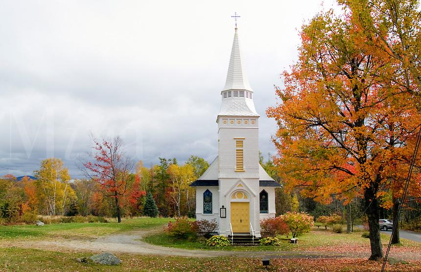 White church in fall foliage.St Matthews Episcopal Church in Sugar Hill, New Hampshire