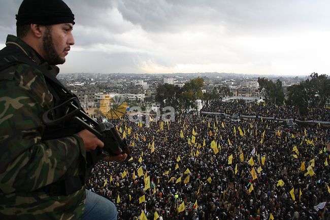 Palestinian Fatah militants, loyal to their leader Mahmud Abbas, participate in a rally in Gaza City to celebrate 42 years since the party's founding. Abbas dug in his heels in a standoff with the ruling Hamas movement today, amid fears that the political tensions could again erupt into deadly factional violence in Gaza. Abbas told top officials from his Fatah party that he intended to go ahead with his plan to call early elections -- a move rejected by Hamas when it was first announced in mid-December, sparking internecine bloodshed.