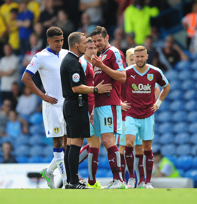Burnley's Lukas Jutkiewicz is sent to the side of the pitch for treatment to an injury by Referee Kevin Friend<br /> <br /> Photographer Chris Vaughan/CameraSport<br /> <br /> Football - The Football League Sky Bet Championship - Leeds United  v Burnley - Saturday 8th August 2015 - Elland Road - Beeston - Leeds<br /> <br /> &copy; CameraSport - 43 Linden Ave. Countesthorpe. Leicester. England. LE8 5PG - Tel: +44 (0) 116 277 4147 - admin@camerasport.com - www.camerasport.com