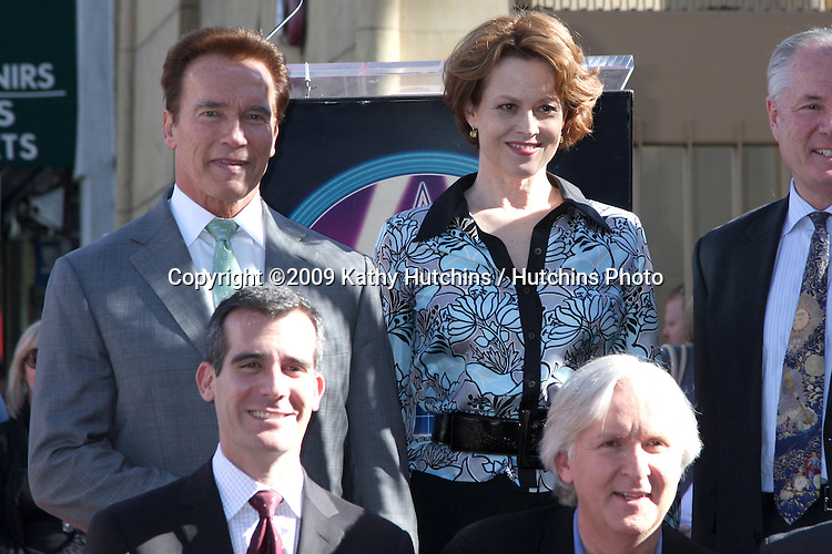 Arnold Schwarzenegger, Sigourney Weaver, James Cameron & City Officials. at the Hollywood Walk of Fame Ceremony for James Cameron.Egyptian Theater Sidewalk.Los Angeles,  CA.December 18, 2009.©2009 Kathy Hutchins / Hutchins Photo.