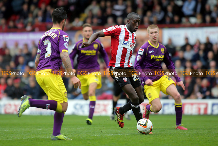 Toumani Diagouraga of Brentford takes on the Notts County defence - Brentford vs Notts County - Sky Bet League One Football at Griffin Park, London - 05/04/14 - MANDATORY CREDIT: Paul Dennis/TGSPHOTO - Self billing applies where appropriate - 0845 094 6026 - contact@tgsphoto.co.uk - NO UNPAID USE