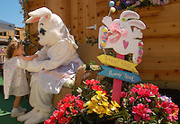 A young girl visits with the Easter Bunny at Birkdale Village in Huntersville, NC. Birkdale Village combines the best of shopping, dining, apartments and entertainment venues within a 52-acre mixed-use development.