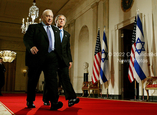 United States President George W. Bush, right, walks with Prime Minister Ariel Sharon of Israel after speaking to reporters at the White House in Washington, DC. on April 14, 2004.  Bush announced he would support Israel's planned unilateral pullout from the Gaza Strip.  <br /> Credit: Mark Wilson / Pool via CNP