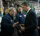 Bedford Heights, OH - January 16, 2009 -- United States President Elect Barack Obama (R) talks with workers during a tour of Cardinal Fastener & Specialty Company, Inc., in Bedford Heights, Ohio, USA, 16 January 2009.  Obama met with workers at the plant, which manufactures parts used to construct wind turbines,  and spoke about an American Recovery and Reinvestment Plan, which would aim to create nearly half a million American jobs by investing in clean energy.  .Credit: David Maxwell - Pool via CNP