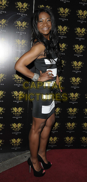 Karen Bryson<br /> The Lipsy VIP Fashion Awards 2013, DSTRKT, Rupert St., London, England.<br /> May 29th, 2013<br /> full length black strapless white side dress hand on hip <br /> CAP/CAN<br /> &copy;Can Nguyen/Capital Pictures