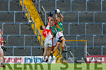 Colin McGillicuddy claims the ball ahead of team mate Mike Breen Mid Kerry  and Kevin Gorman Kilcummin during their SFC clash in Fitzgerald Stadium on Saturday