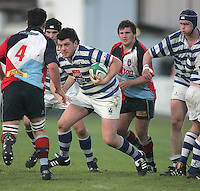 Dungannon number 8 Stuart Lamb runs at Harlequins second row Gareth Rourke during the First Trust Senior Cup Final at Ravenhill. Result - Dungannon 27pts Harlequins 10pts.