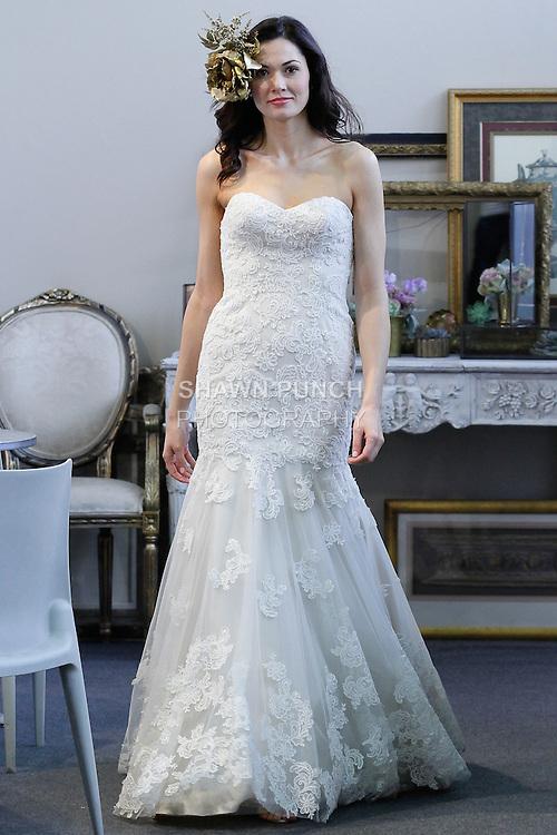 Model walks runway in Wtoo Brides Fall 2013 bridal gown by Vatana Watters, during NY International Bridal Week on April 20, 2013.