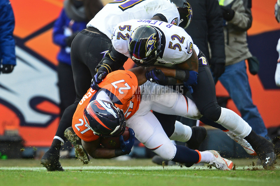 Jan 12, 2013; Denver, CO, USA; Baltimore Ravens linebacker Ray Lewis (52) tackles Denver Broncos running back Knowshon Moreno (27) during the AFC divisional round playoff game at Sports Authority Field.  The Ravens defeated the Broncos 38-35 in double overtime. Mandatory Credit: Mark J. Rebilas-