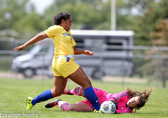 BROOKINGS, SD - AUGUST 13: Leah Manuleleua #11 from South Dakota State tries to get a shot past goalie Justina Jarmoszko #1 from Manitoba during the first half of their exhibition match Sunday afternoon at Fishback Soccer Park in Brookings. (Photo by Dave Eggen/Inertia)
