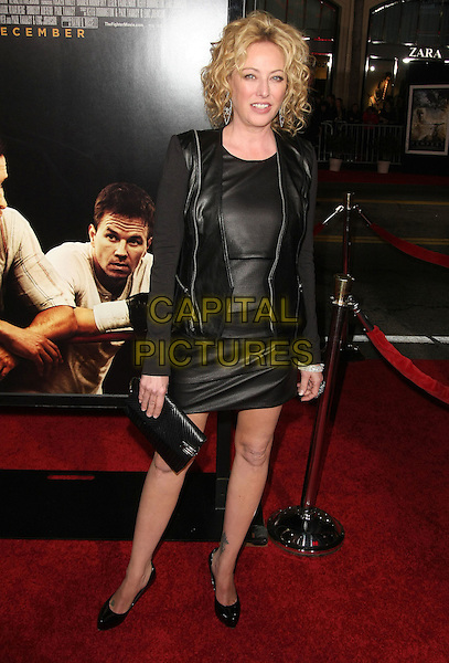 "VIRGINIA MADSEN.""The Fighter"" Los Angeles Premiere held at Grauman's Chinese Theater, Hollywood, California, USA..December 6th, 2010.full length black leather dress jacket shoes clutch bag .CAP/ADM/TB.©Tommaso Boddi/AdMedia/Capital Pictures."