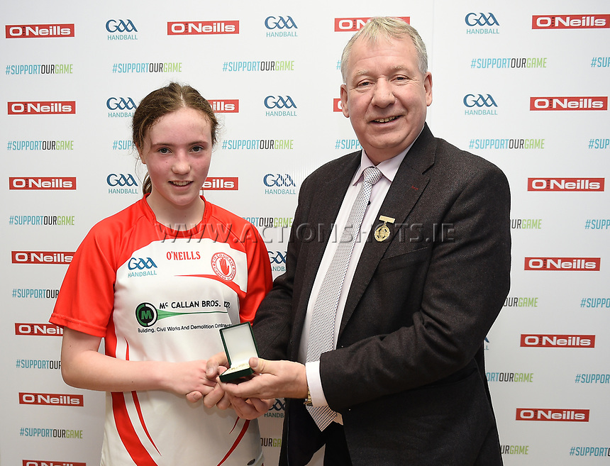 19/03/2018; 40x20 All Ireland Juvenile Championships Finals 2018; Kingscourt, Co Cavan;<br /> Girls Under-14 Singles; Kilkenny (Amy Brennan) v Tyrone (Clodagh Munroe)<br /> Clodagh Munroe is presented with her winners medal by GAA Handball President Joe Masterson<br /> Photo Credit: actionshots.ie/Tommy Grealy