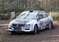 Dale Robertson - Paul McGuire in a Mitsubishi Lancer Evolution 9 competing at Junction 6 on the Munro Scotch Beef Millbuie Special Stage 1 on the 2014 Arnold Clark/Thistle Hotel Snowman Rally, supported by Highland Office Equipment, part of Capital Document Solutions which was organised by Highland Car Club and based in Inverness on 22.2.14; Round 1 of the 2014 RAC MSA Scottish Rally Championship sponsored by ARR Craib Transport Limited.