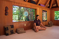 A woman meditates in a room at Breitenbush Hot Springs in the Cascade Mountain range of Central Oregon
