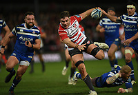 4th January 2020; Kingsholm Stadium, Gloucester, Gloucestershire, England; English Premiership Rugby, Gloucester versus Bath; Jake Polledri of Gloucester bursts through the tackle from Tom Homer of Bath - Editorial Use