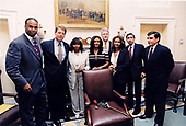 United States President Bill Clinton presents Ms. Alma Brown, wife of the late US Secretary of Commerce Ronald H. Brown, his Cabinet Room chair in a brief ceremony before a regularly scheduled Cabinet<br /> meeting at the White House in Washington, DC on July 18, 1996.  The presentation took place in the Cabinet Room. Pictured, from left to right,  Michael Brown, US Vice President Al Gore, Alma Brown, Tracy Brown, President Clinton, Acting US Secretary of Commerce Mickey Kantor, and US Secretary of Transportation Federico Peña.<br /> Mandatory Credit: Robert McNeely / White House via CNP