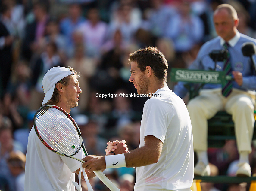 01-07-13, England, London,  AELTC, Wimbledon, Tennis, Wimbledon 2013, Day seven, Juan Martin Del Potro (ARG)<br /> is being congratulated by Andreas Seppi (ITA)(L)<br /> <br /> <br /> <br /> <br /> Photo: Henk Koster