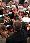 United States President George W. Bush greets sailors and other members of the military at NATO ACLANT headquarters at the Norfolk Naval Air Station on February 13, 2001 in Norfolk, Virginia. President Bush visited several military bases last week to reaffirm his commitment to improve living conditions for the people who serve in America's armed forces. <br /> Mandatory Credit: Paul Morse / White House via CNP