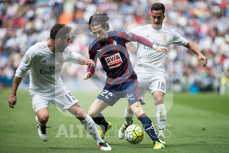 Real Madrid's Daniel Carvajal and Lucas Vazquez and Sociedad Deportiva Eibar's Jota Peleteiro during La Liga match. April 09, 2016. (ALTERPHOTOS/Borja B.Hojas)