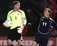 Zac McMath #1 of the University of Maryland takes the ball away from Corey Hertzog #11of Penn State during an NCAA 3rd. round match at Ludwig Field, University of Maryland, College Park, Maryland on November 28 2010.Maryland won 1-0.