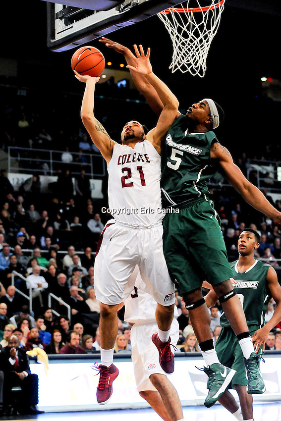 Colgate Raiders guard Damon Sherman-Newsome (21) and Providence Friars forward Sidiki Johnson (5) during the NCAA basketball game between the Providence College Friars and the Colgate University Raiders at the Dunkin Donuts Center. Eric Canha/CSM