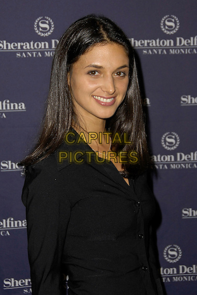 ANDREA GABRIEL.Members from the original recording and a variety of today's stars gathered to celebrate the production of the Anniversary Collectors' Edition of the Children of the World, Santa Monica, CA, USA, February 26th, 2010. .arrivals half length black shirt smiling .CAP/CEL/RL .©Rich Linton/CelPh/Capital Pictures