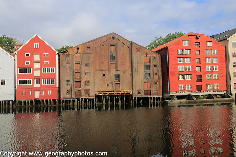 Historic waterside warehouse buildings on River Nidelva, Bryggene, Trondheim, Norway
