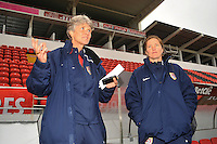 USA coach Pia Sundhage (L) and assistant coach Hege Riise (R). The USA defeated Norway 2-1 at Olhao Stadium on February 26, 2010 at the Algarve Cup.