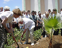 "Photo File/ The former president Jimmy Carter (C) , plants a tree next to his wife Rosalynn Carter (L) and the Cuban Parliament's president Ricardo Alarcon in the Primary School ""Frank Pais"", in the town of ""The Guasimas"", May 15/2002. Carter is on a six-day visit to Cuba, and is the first American president to visit the communist island since Fidel Castro took power in 1959. Credit: Jorge Rey/MediaPunch"