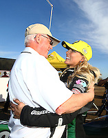 Feb 28, 2016; Chandler, AZ, USA; NHRA top fuel driver Leah Pritchett (right) is congratulated by NHRA official Graham Light as she celebrates after winning the Carquest Nationals at Wild Horse Pass Motorsports Park. Mandatory Credit: Mark J. Rebilas-
