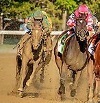 August 24, 2019: Code Of Honor [green] circles the field to make up four lengths to win the Runhappy Travers Stakes at Saratoga Race Course in Saratoga Springs, New York. Heary/Eclipse Sportswire/CSM.