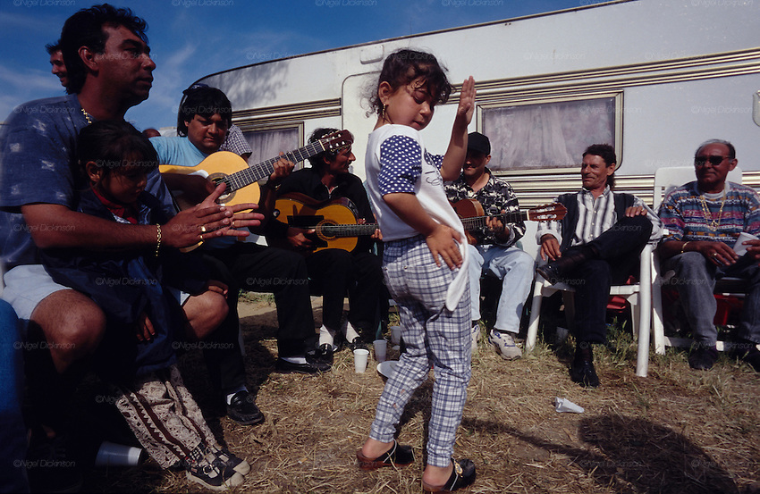Europe, France, Camargue, Saintes Maries de la Mer, Gypsy Pilgrimmage 'Pelerinage des Gitans aux Saintes Maries de la Mer'. Festivities at the Baptiste family camping after a christening. Gypsies from all over the world come to celebrate their patron Saint Sara who is carried by them from the church to the sea-shore. May 24th and 25th every year.