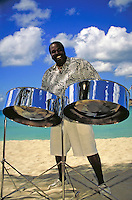 steel pan player Andrew Douglas plays his tunes on the beach. Andrew Douglas. St Thomas, US Virgin Islands Caribbean.