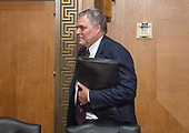 Charles P. Rettig walks to the witness table prior to giving testimony before the United States Senate Committee on Finance on his nomination to be Commissioner Of Internal Revenue (IRS) on Capitol Hill in Washington, DC on Thursday, June 28, 2018.<br /> Credit: Ron Sachs / CNP