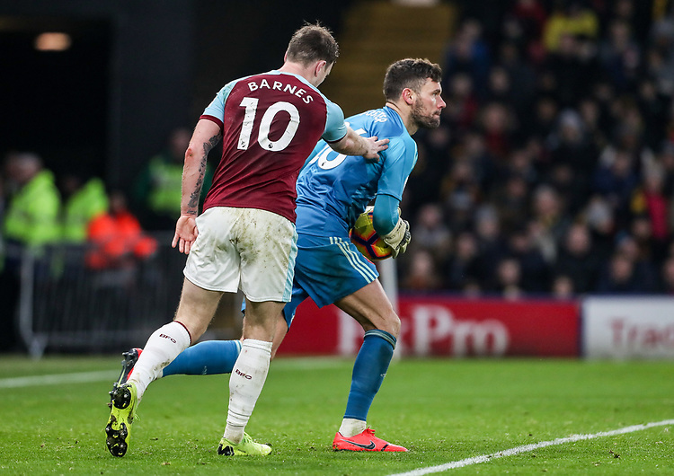 Burnley's Ashley Barnes beaten to the ball by Watford's goalkeeper Ben Foster<br /> <br /> Photographer Andrew Kearns/CameraSport<br /> <br /> The Premier League - Watford v Burnley - Saturday 19 January 2019 - Vicarage Road - Watford<br /> <br /> World Copyright © 2019 CameraSport. All rights reserved. 43 Linden Ave. Countesthorpe. Leicester. England. LE8 5PG - Tel: +44 (0) 116 277 4147 - admin@camerasport.com - www.camerasport.com