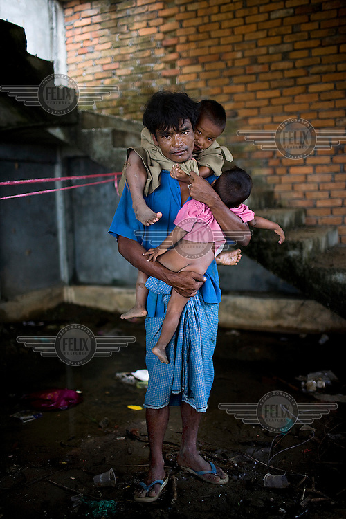 When Cyclone Nargis hit the Irrawaddy Delta on 02/05/2008, all 39 year old U Kyow Soe could carry were his two sons. As a fisherman, Soe is rarely scared by extreme weather, but when the cyclone hit he knew it was serious. He carried both his sons, five year old That Pyine and three year old Ei Toe, on his back as he fled with his wife.ASoe and his family live alongside other refugees from the 7th ward, Hlaingthaya township in Rangoon (Yangon), in the Shwe Than Lwin shopping complex, which is under construction and has acted as a small refugee centre.
