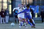 29 November 2013: Duke's Natasha Anasi (4) and Virginia Tech's Ashley Meier (left). The Virginia Tech University Hokies played the Duke University Blue Devils at Thompson Field in Blacksburg, Virginia in a 2013 NCAA Division I Women's Soccer Tournament Quarterfinal match. Virginia Tech won the game 3-0.