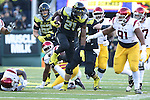 Nov 21, 2015; Eugene, OR, USA; Oregon Ducks running back Royce Freeman (21) runs through \USC Trojans' defenders at Autzen Stadium. <br /> Photo by Jaime Valdez
