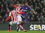 Fernandinho of Manchester City skips past Victor Moses of Stoke City - Barclays Premier League - Stoke City vs Manchester City - Britannia Stadium - Stoke on Trent - England - 11th February 2015 - Picture Simon Bellis/Sportimage
