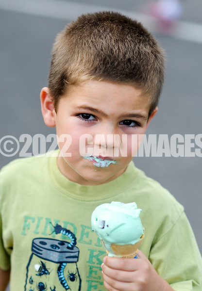 Jackson Dean 5 of Levittown, Pennsylvania has an ice cream cone as family and community members of Samuel Everitt Elementary School held an outdoor celebration Saturday May 30, 2015 in Middletown, Pennsylvania. (Photo by William Thomas Cain/Cain Images)