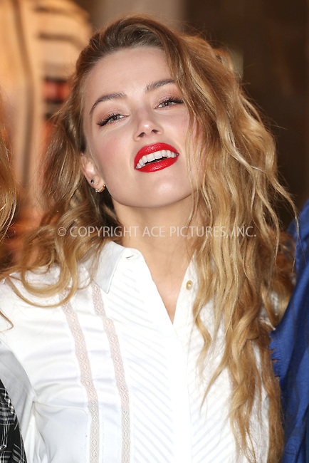 WWW.ACEPIXS.COM<br /> <br /> February 20 2015, London<br /> <br /> Amber Heard unveils 'Alice in Wonderland for Temperley' at the Temperley store on February 20 2015 in London <br /> <br /> By Line: Famous/ACE Pictures<br /> <br /> <br /> ACE Pictures, Inc.<br /> tel: 646 769 0430<br /> Email: info@acepixs.com<br /> www.acepixs.com