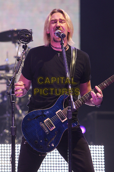 NICKELBACK.Live at the O2 Arena, London, England..September 19th, 2008.stage concert gig performance music Chad Kroeger half length singing guitar black t-shirt .CAP/MAR.© Martin Harris/Capital Pictures.
