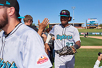 Salt River Rafters outfielder Jerar Encarnacion (27), of the Miami Marlins organization, celebrates with teammates after winning the Arizona Fall League Championship Game against the Surprise Saguaros on October 26, 2019 at Salt River Fields at Talking Stick in Scottsdale, Arizona. The Rafters defeated the Saguaros 5-1. (Zachary Lucy/Four Seam Images)
