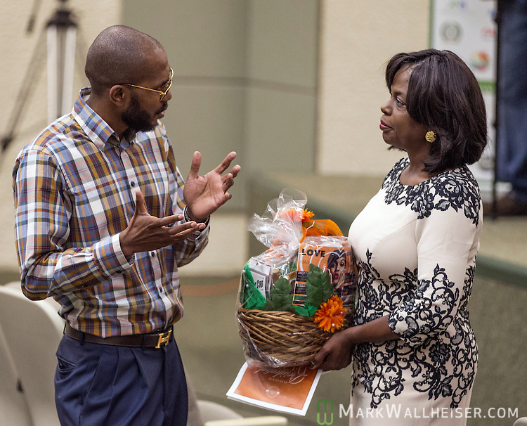 FAMU president Dr. Elmira Mangum receives a gift basket prior to the FAMU Inaugural Presidential Lecture Series at the College of Pharmacy &amp; Pharmaceutical Sciences in Tallahassee September 30, 2014.  The featured speaker was Dr Jasmine Bowers.<br /> .com