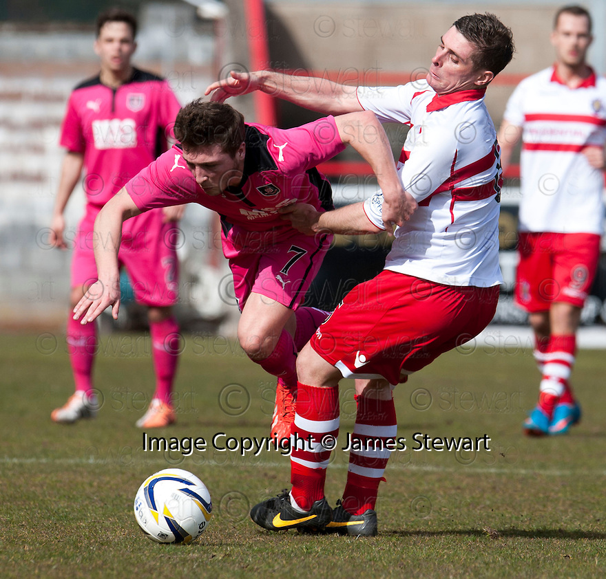 Airdrie's Scott Gray is held back by Stirling's Ross Forsyth.