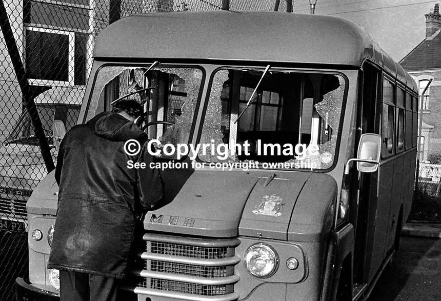 A detective examines the school bus which was ambushed in a Provisional IRA gun attack at Ardboe, Cookstown, N Ireland. The driver of the vehicle, an off-duty reserve policeman, and his passengers, two children, escaped injury despite the vehicle being hit by 15 shots. 197601210052..Copyright Image from Victor Patterson, 54 Dorchester Park, Belfast, UK, BT9 6RJ..Tel: +44 28 9066 1296.Mob: +44 7802 353836.Voicemail +44 20 8816 7153.Skype: victorpattersonbelfast.Email: victorpatterson@me.com.Email: victorpatterson@ireland.com (back-up)..IMPORTANT: If you wish to use this image or any other of my images please go to www.victorpatterson.com and click on the Terms & Conditions. Then contact me by email or phone with the reference number(s) of the image(s) concerned.