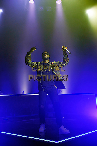 LONDON, ENGLAND - FEBRUARY 14: Tinie Tempah(Patrick Chukwuemeka Okogwu) performing for 'War Child' at Shepherd's Bush Empire on February 14, 2017 in London, England.<br /> CAP/MAR<br /> &copy;MAR/Capital Pictures
