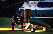 United States President Obama salutes the Marine Guard as he exits Marine One after returning to the White House in Washington, DC on Friday, 31 August 2012 from Fort Bliss, Texas. .Credit: Bill Auth / Pool via CNP
