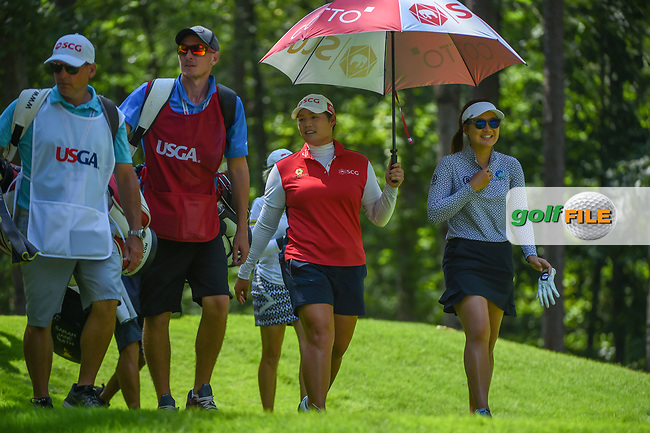 Ariya Jutanugarn (THA) and Su Oh (AUS) watch a photographer take a spill off the hill as they head down 2 during round 3 of the U.S. Women's Open Championship, Shoal Creek Country Club, at Birmingham, Alabama, USA. 6/2/2018.<br /> Picture: Golffile   Ken Murray<br /> <br /> All photo usage must carry mandatory copyright credit (© Golffile   Ken Murray)